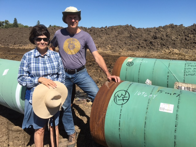 Iowa landowner Cyndy Coppola and Bold Iowa director Ed Fallon on Cyndy's land where the Dakota Access pipeline is being constructed.